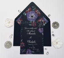 dark floral wedding invitation with matching envelope liner by Fancy Paperie