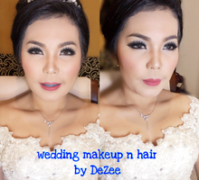 Wedding of Novita  by deZee Makeup and Wedding service