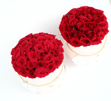 Box of red roses for bridesmaid by Seed & Stem